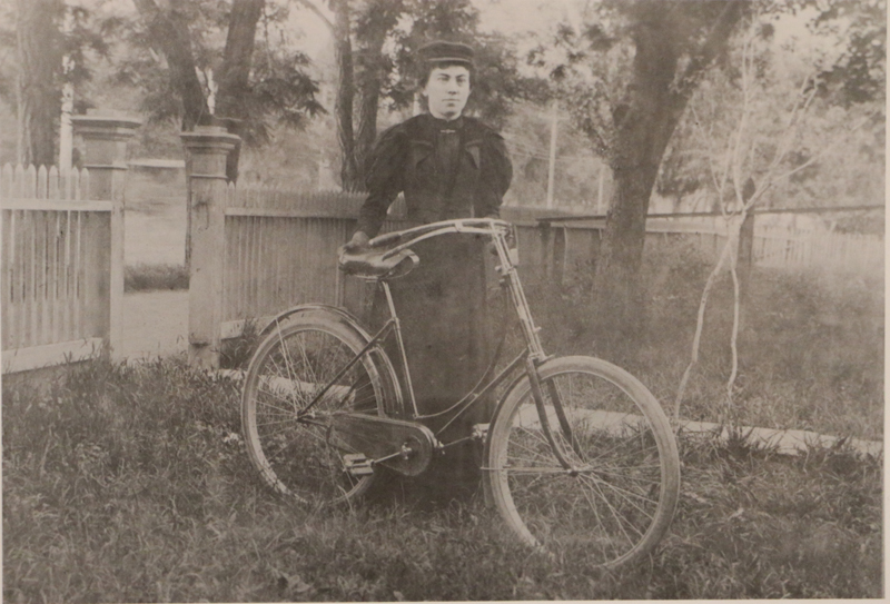 An unidentified woman with a bicycle is shown with members of the first Utah State Legislature in 1896.