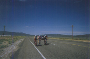 A critical mass of riders forms and echelon along State Highway 56 , west of Cedar City. Photo: Wayne Cottrell