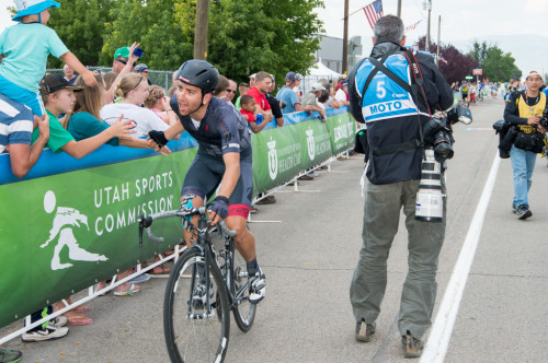 """A Hincapie Team rider giving the """"low five"""" to the fans along the finish line. Photo by Dave Richards, daverphoto.com"""
