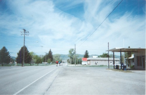 Under a dynamic sky, two riders enter the city of Newton along State Route 23. Photo by Wayne Cottrell.