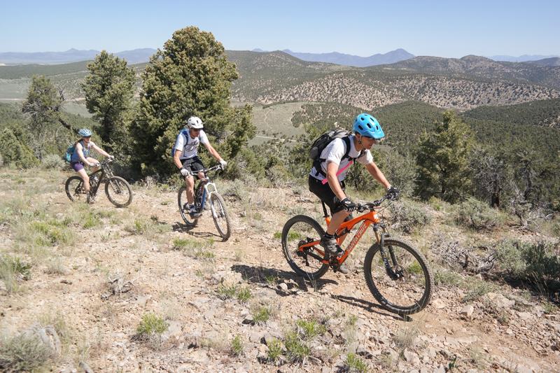 Kent Robertson (front), Nathan Bake and Jenni Shafer, climbing some simgletrack on Ward Mountain,