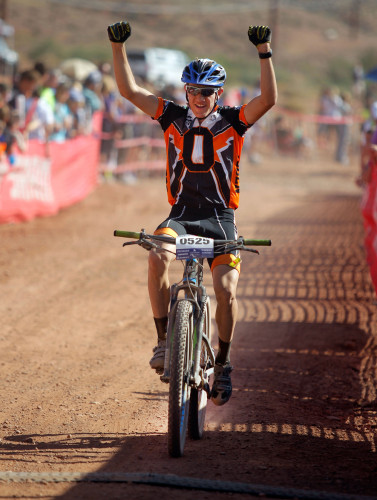 Jacob Mathewson of Ogden High crosses the finish line at the Utah High School Mountain Biking State Championships, October 25, 2014 in St. George, Utah. Photo by Steve C. Wilson. See more event photos at wilsonphotography.com