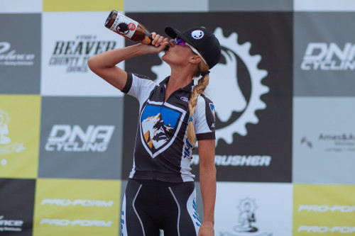 KUHL's Joey Lythgoe savors the spoils of victory as the 2014 Crusher Pro Women's champion. Photo byCatherine Fegan Kim/Cotton Sox Photography.