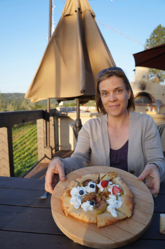 Lynda showing off a wood-fired dessert pizza at the Fitzpatrick Winery.