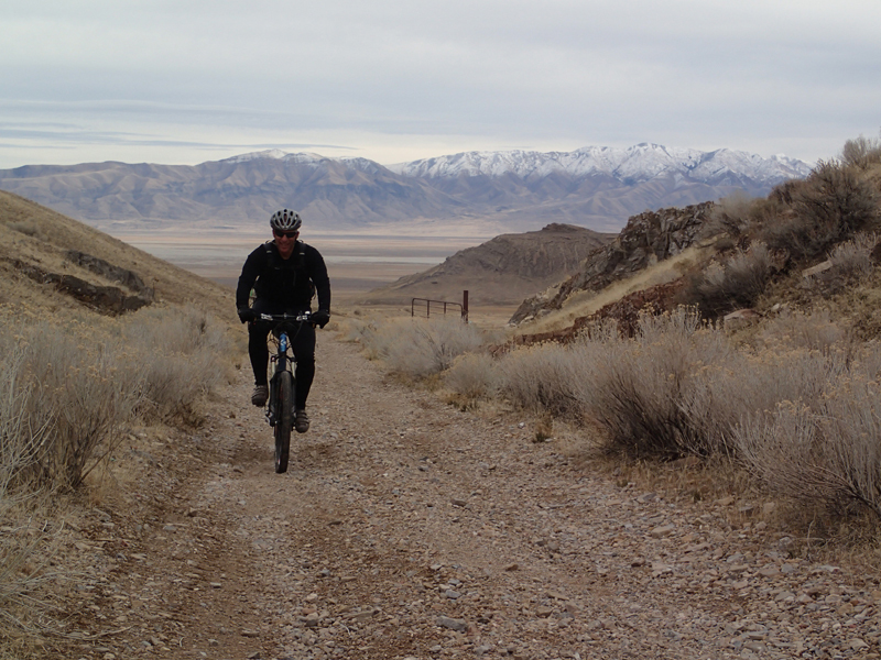 Some of the great scenery at the Wild Horse Dirt Fondo. Dave Gontrum begins the climb of the Hastings Cutoff Pass from the east side of the Cedar Mountain Wilderness. The climb gains about 950 feet over 3.3 miles, topping out at 5,775 feet. The Stansbury Mountains are in the background, about 15 miles to the east.
