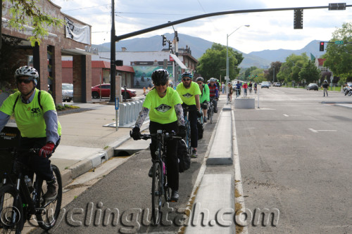 Cyclists riding on Salt Lake City's new protected bike lane on 300 S. Cycling helps our air and health. Photo by Dave Iltis