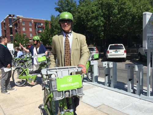 Salt Lake City Mayor Ralph Becker rode a GreenBike to and from the UCAIR Station dedication on June 2, 2015. Photo by Dave Iltis
