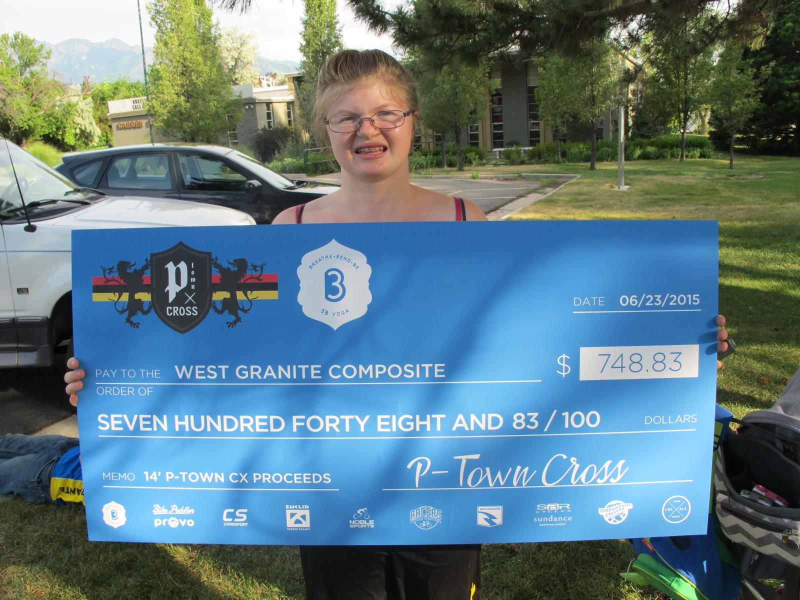 Joe Johnson, right, of the P-Town Cross series, presents the West Granite Composite High School Mountain Biking Team a $748 donation. Photo courtesy Joe Johnson