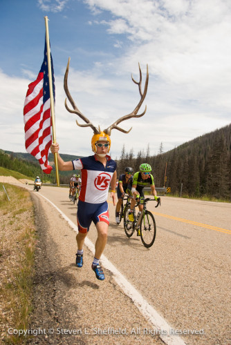 Antler Man running with the break at Wolf Creek Pass in stage 4 of the 2015 Tour of Utah.  Photo by Steven Sheffield