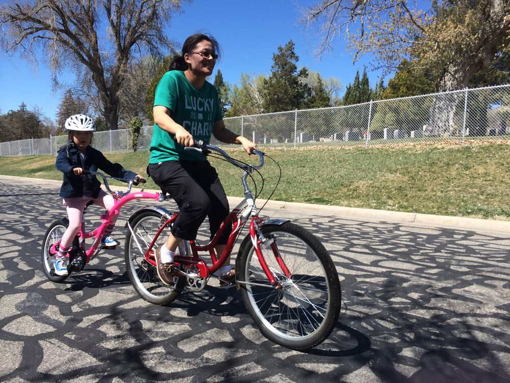Woman and boy on a bike