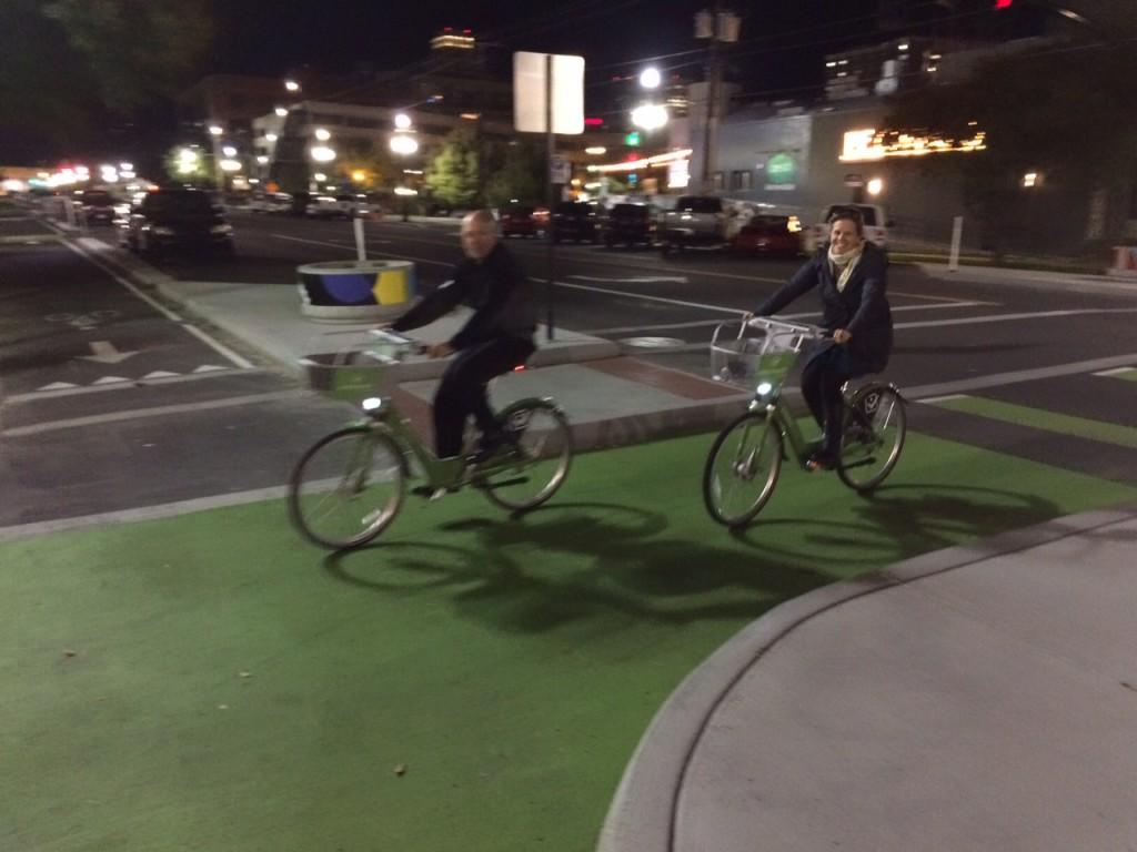 Gary Sjoquist and Ashley Korenblatt ride GreenBikes in downtown Salt Lake City. Photo by Dave Iltis