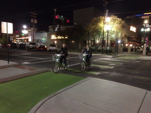 Gary Sjoquist and Ashley Korenblatt travel through Salt Lake City's new protected intersection at 200 S. and 300 W. The new bicycle master plan will produce further innovations such as this. Photo by Dave Iltis