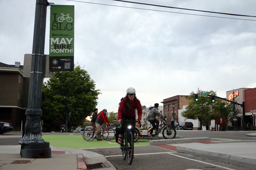 Heidi Goedhart, UDOT's new Bicycle and Pedestrian Coordinator, rides through Salt Lake City's trend setting protected intersection at 300 S. and 200 W. The Bike Month banners will be up throughout May to celebrate the bicycle!