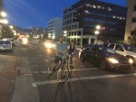 2 Riders on the new 300 S. Protected Bike Lane. Photo by Dave Iltis