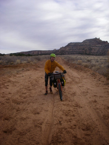 Most everything is great about southern Utah bike touring…..but sand can be a challenge! It's not too bad on the Notom road, fortunately. Photo by Tom Diegel