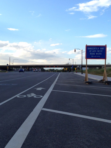 Redwood Road is part of the Wasatch Front Regional Council's Bicycle Priority Network. This section, by the Bangerter Highway has bike lanes (although the one pictured here is too narrow). UDOT is proposing to remove lanes from 10440 S to 12600 S. Photo by Lisa Hazel