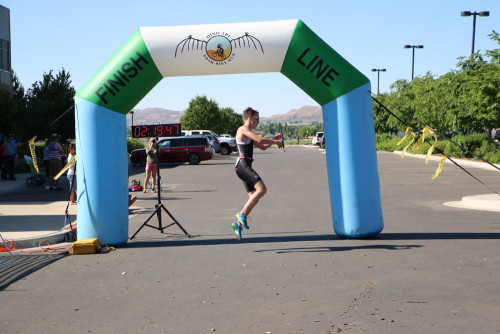 Julian Pellmann celebrates his win in the Men's Olympic open category at the 2016 DinoTri in Vernal, Utah. Photo by Dave Iltis
