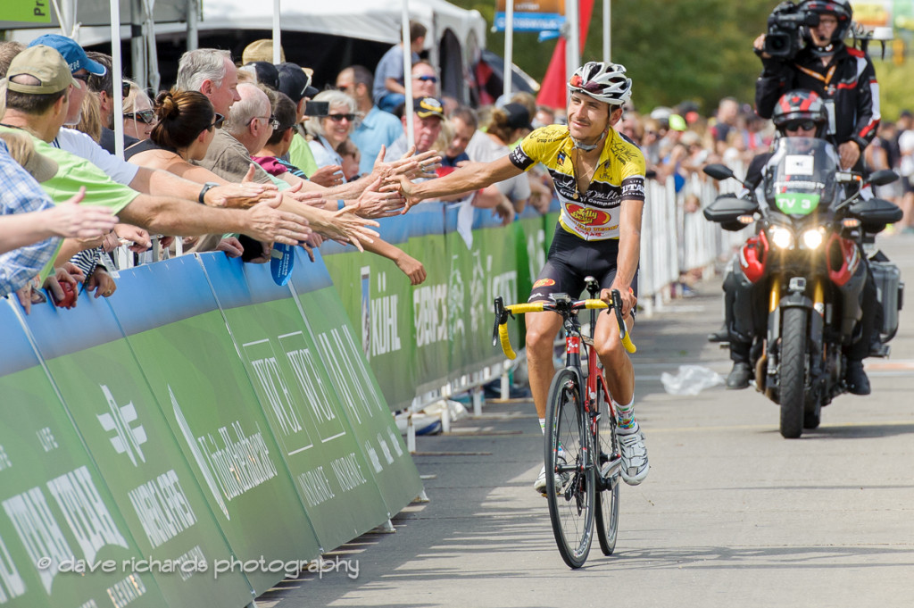 Yellow jersey leader Lachlan Morton (Jelly Belly Maxxis) high fives the fans along the finish of Stage 5, 2016 Tour of Utah. Photo by Dave Richards, daverphoto.com