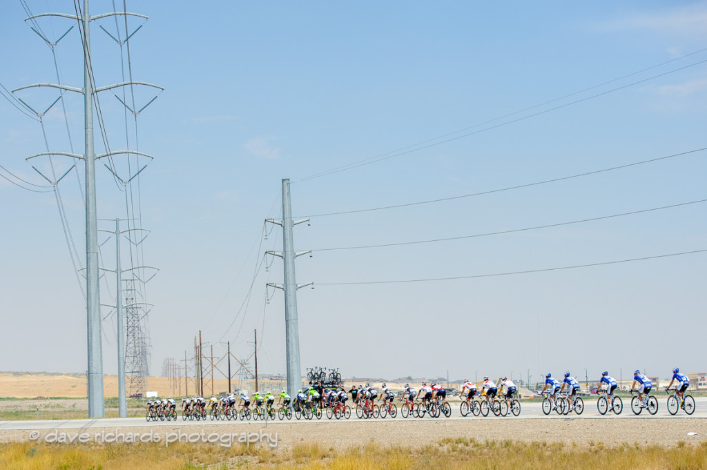 Riders are dwarfed by high voltage power lines during Stage 4, 2016 Tour of Utah. Photo by Dave Richards, daverphoto.com