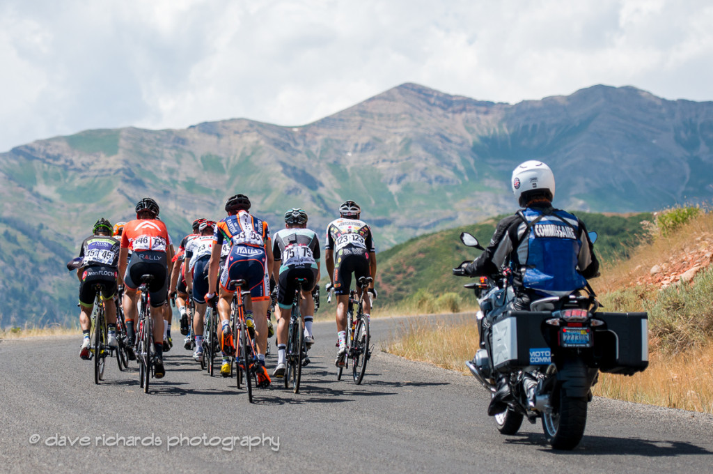 A small group of riders under the watchful eye of the moto commissaire, Stage 3, 2016 Tour of Utah. Photo by Dave Richards, daverphoto.com