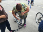 Learning to change a tire. Photo by May Romo and Merecedes Rodriguez