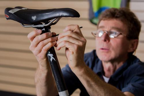 Adjusting saddle mountain bike