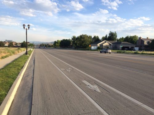 The ATIP is planning for more bike lanes throughout Salt Lake County. The lane shown here on Redwood Road in S. Jordan is of sub-standard width. The ATIP process allows for commenting on issues like this, and on the planned bike routes. Photo by Dave Iltis