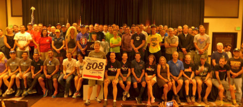 Chris Kostman is stepping down as the 508 race director. He's shown here with the group holding the sign. Photo courtesy Chris Kostman, The508.com