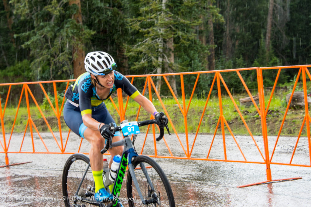 Mindy McCutcheon crosses the line to take a hard fought second place. Photo by Steven Sheffield