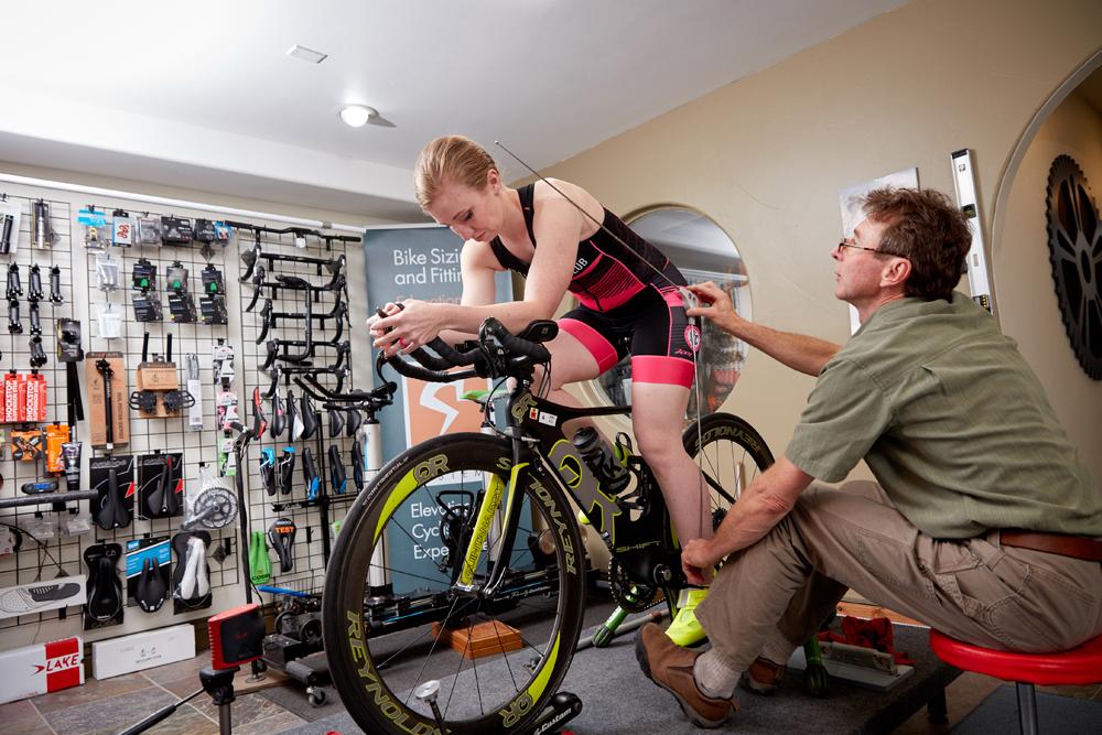 John Higgins takes measurements during a bike fit at the Bike Fitr studio. Photo by Derek Israelsen Photography