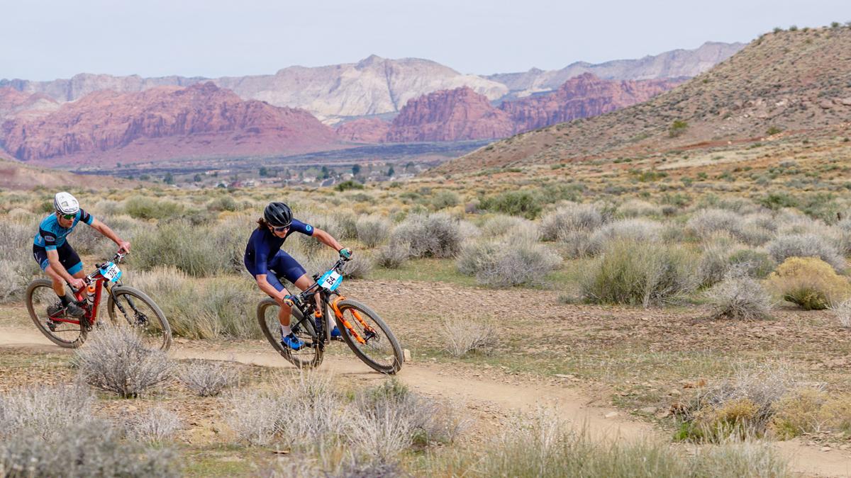 Zach Calton leads Justin Lindine through the Red Rocks of Southern Utah. Photo by Matt Ohran