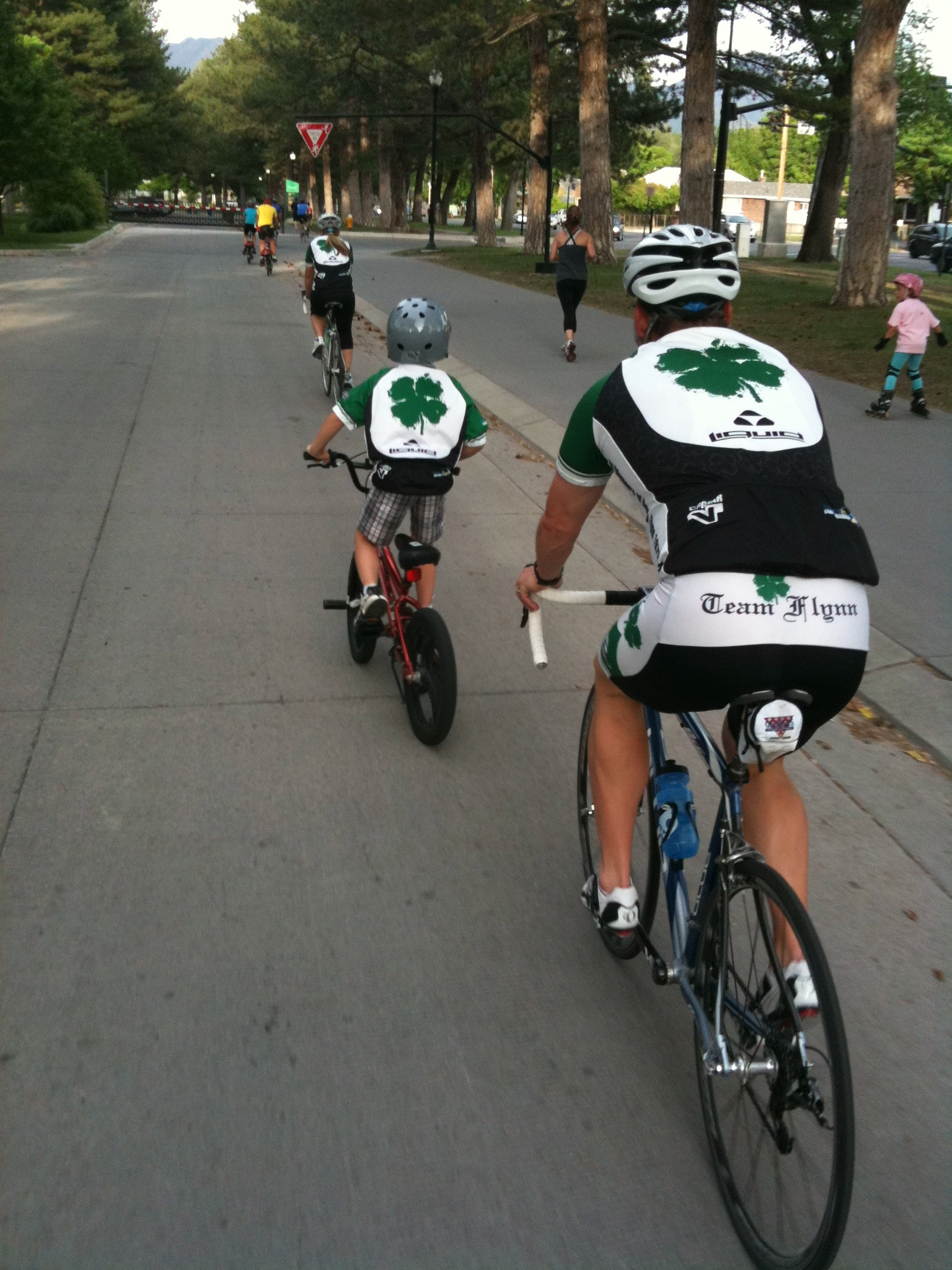 A family rides in the Ride of Silence to honor their fallen relative. Photo by Dave Iltis