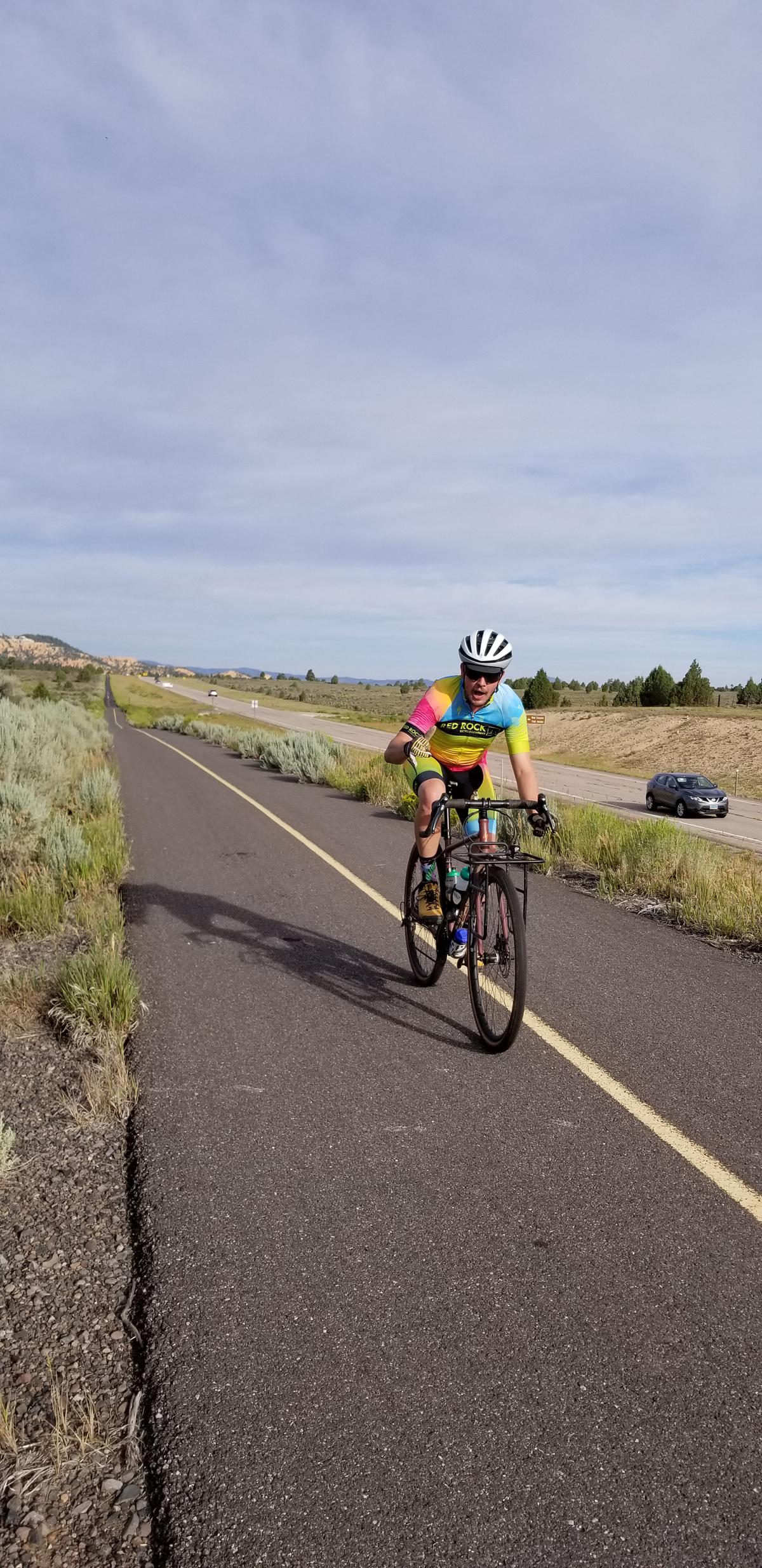 Joey Dye rocking the bike path on the return trip down the bike path in Red Canyon. Photo by Lukas Brinkerhoff