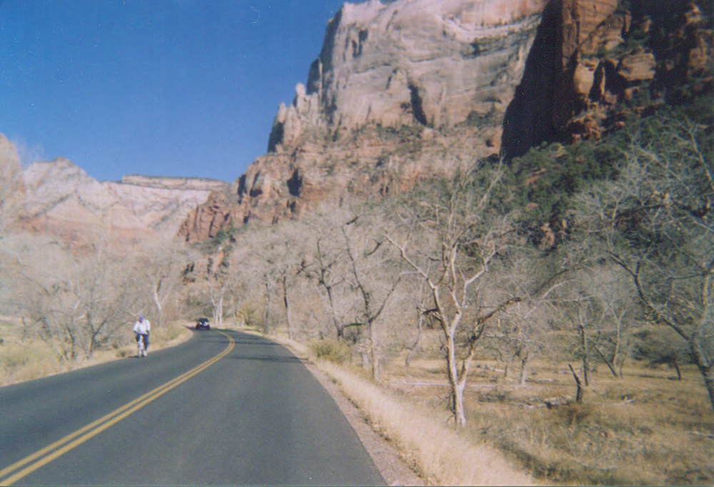 Court adjourned. A rider pedals out of the Court of the Patriarchs in Zion National Park. Photo by Wayne Cottrell