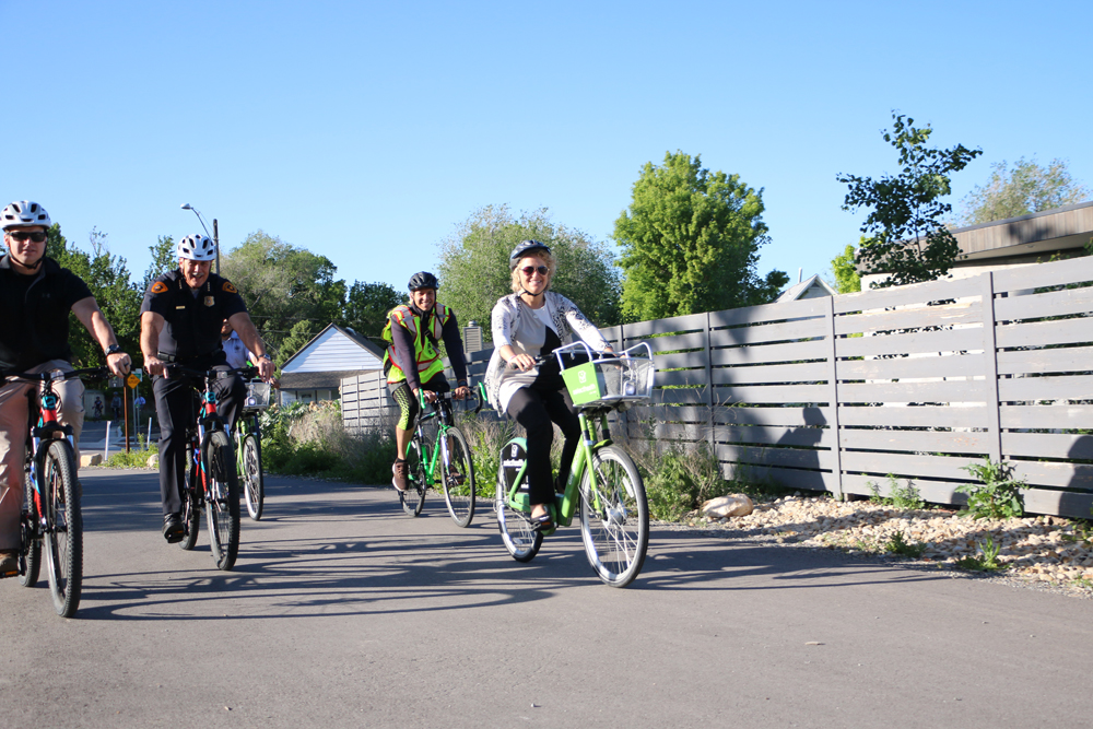 Salt Lake City Mayor Jackie Biskupski and police chief Mike Brown ride on the McClelland Trail during May's Bike to Work Day. Salt Lake City has made improvements, but has a long way to go to catch up to the top biking cities in the West. Photo by Dave Iltis