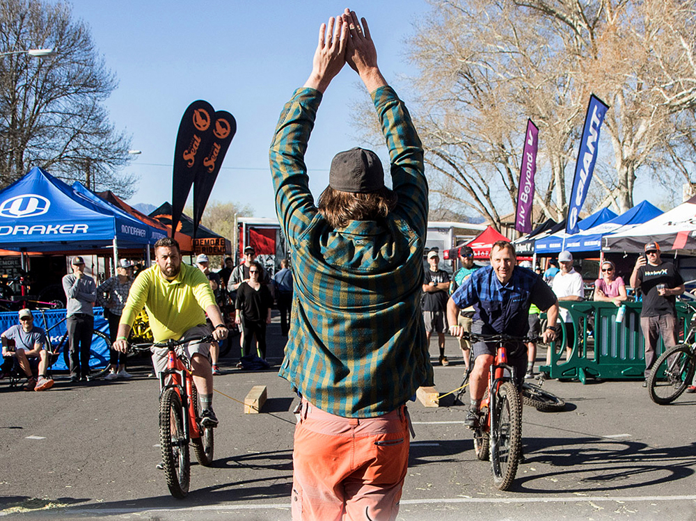 """After the rides are over, there's all kinds of fun to be had back at festival venue. The log pull is a bracket-style competition where cyclists pull a 4x4 """"log"""" in a head-to-head race. Photo by John Shafer/Photo-John.net"""