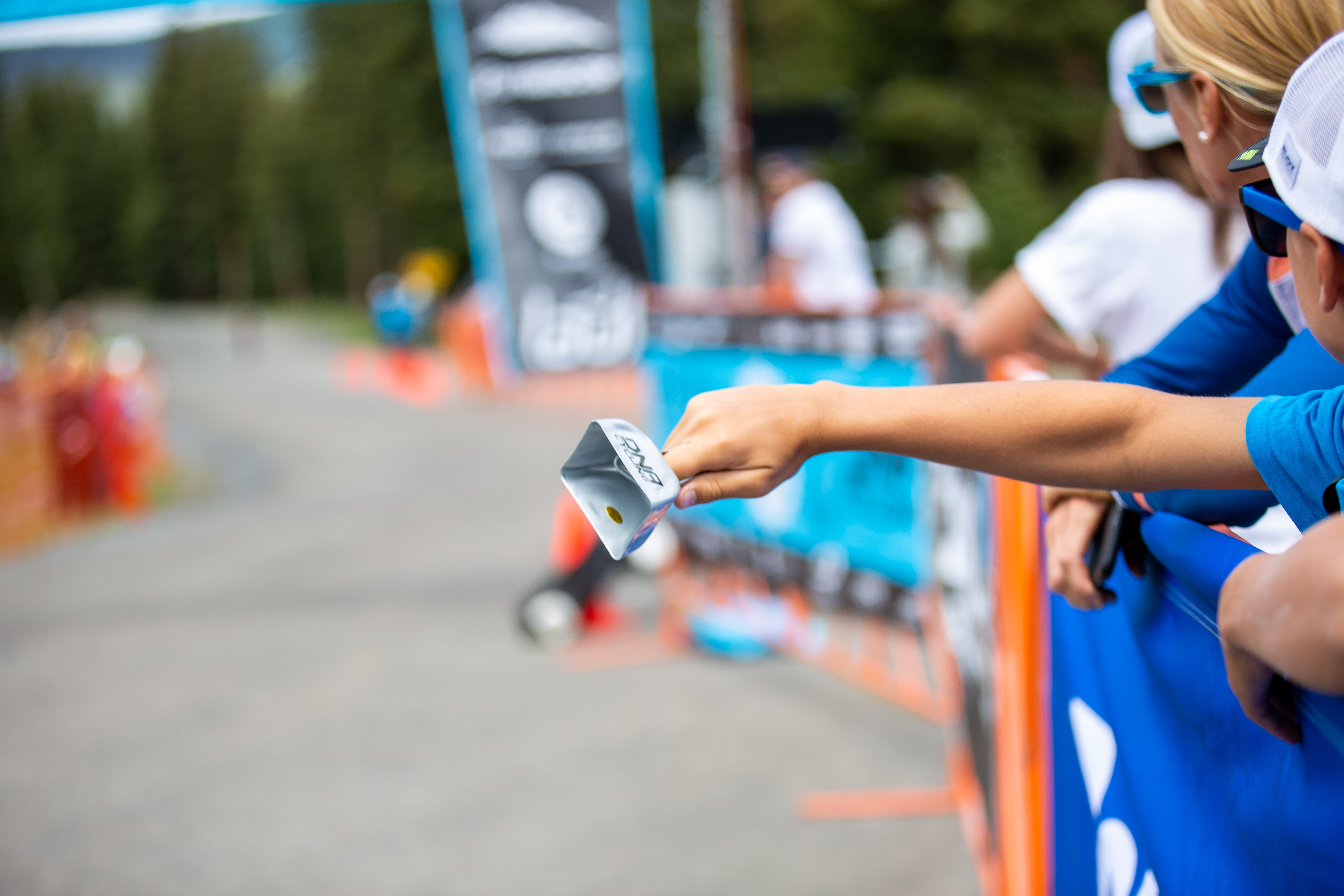 A young fan rings a cowbell at the finish line. Photo: Angie Harker.