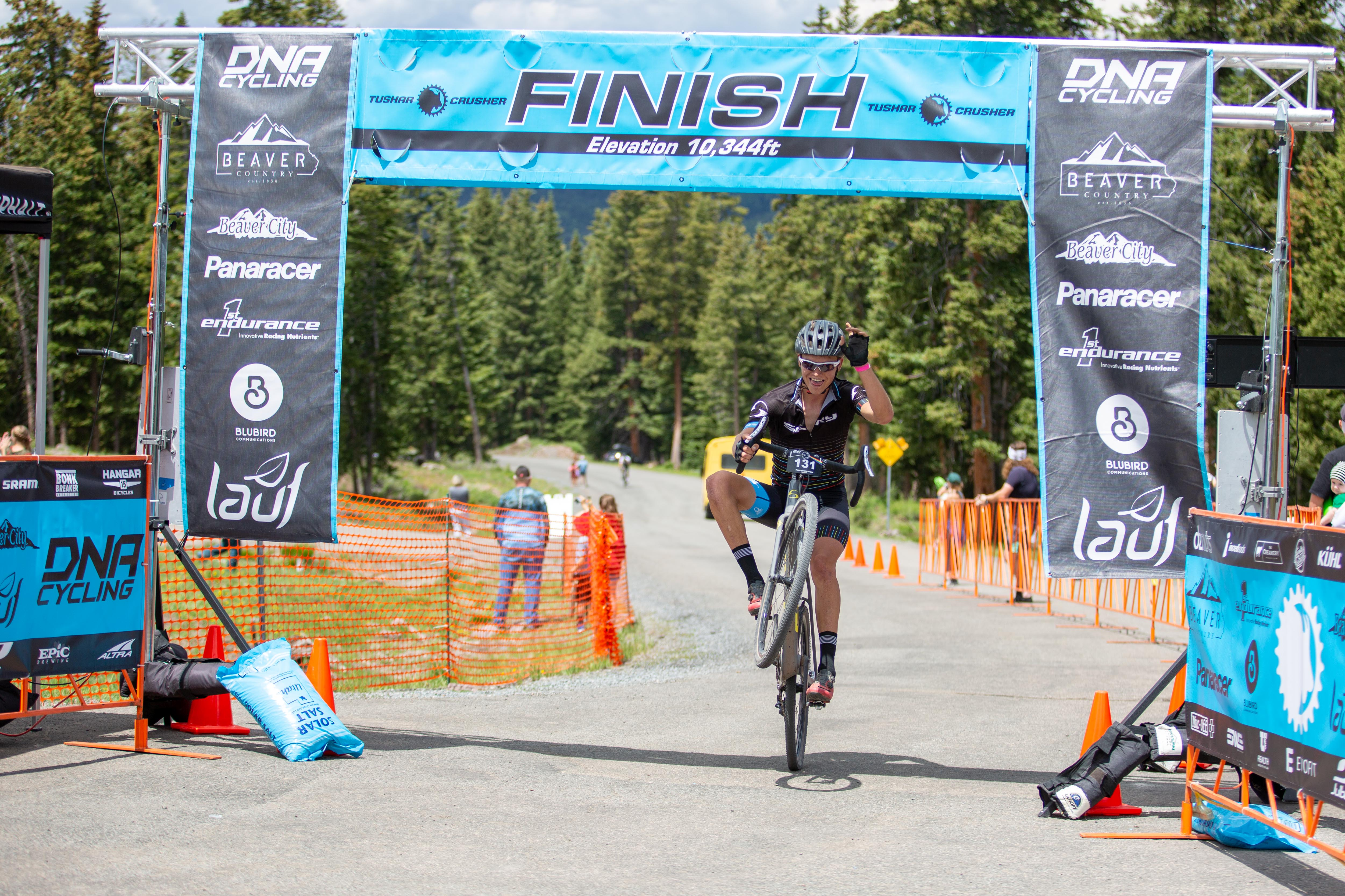 18-year old Andrew Conover pops a wheelie coming across the line to win the 29 and Under age group. Photo: Angie Harker.