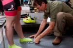 John Higgins measuring feet for cycling shoes. Photo by Derek Israelsen