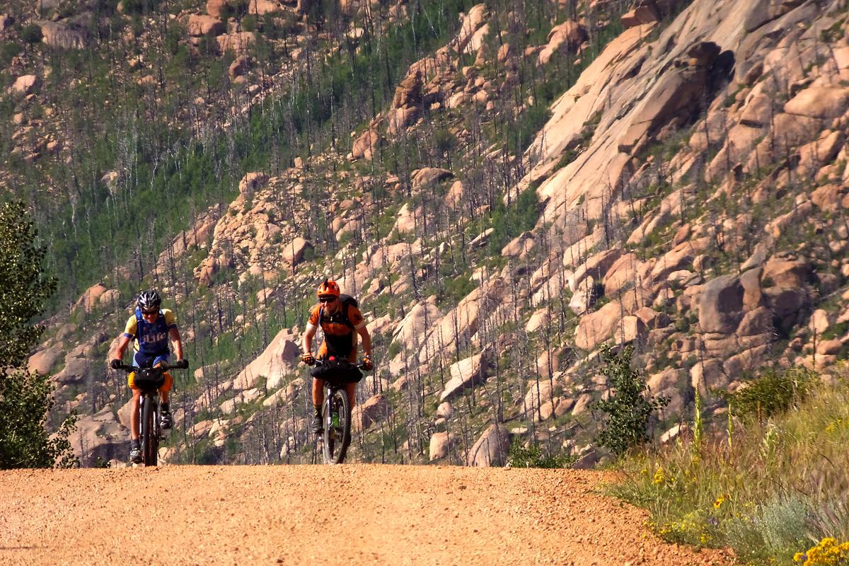 Ty Hopkins and Jeff Hemperley riding the Hayman burn area on the Lost Creek Wilderness detour. Photo courtesy Adam Lisonbee