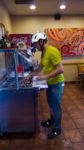 Joey Sparkles demonstrates proper salsa bar safety. Photo by Lukas Brinkerhoff