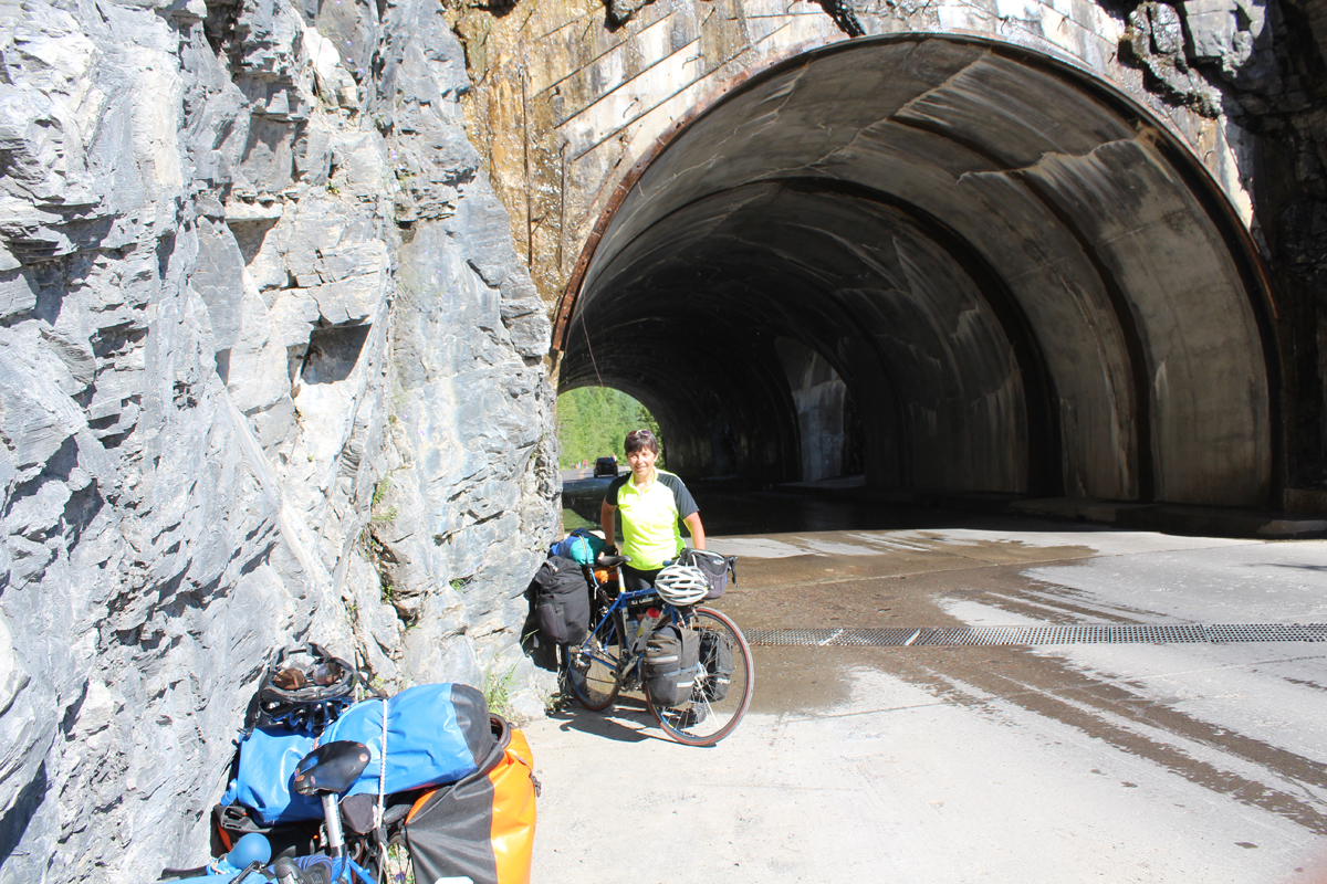 Julie at the tunnel on Going to the Sun Highway, Glacier National Park. Photo by Lou Melini