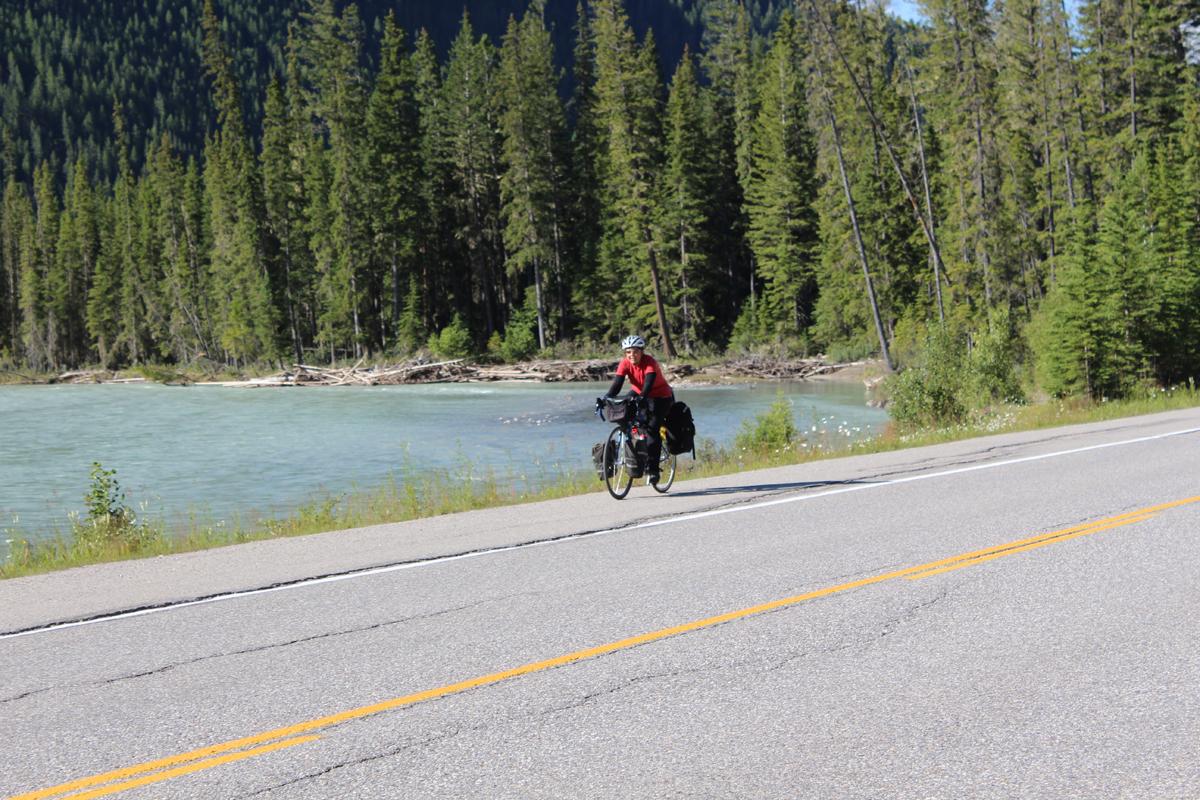 Julie riding along the Kootenay River, Kootenay National Park, Canada.