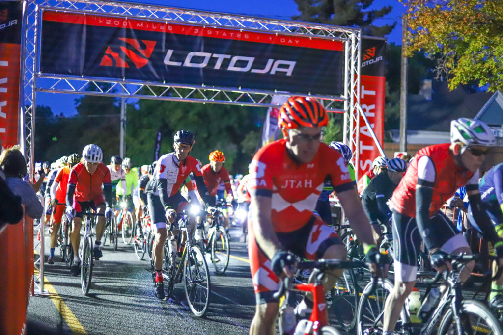 Cyclists leave the start line at Sunrise Cyclery in Logan, Utah, in the 37th Annual LoToJa Classic. The race was held on September 7, 2019. Nearly 2,000 cyclists participated. Photo courtesy of Snake River Photo