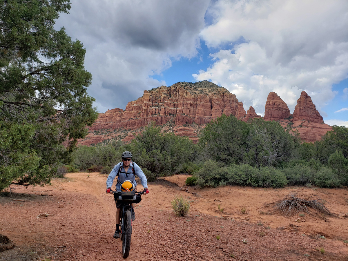 Twin Buttes and Two Nuns rock formations. Slick rock riding near Sedona is similar to Moab but the vegetation is more dense and lush. On the Coconino Loop. Photo by Patrick Walsh