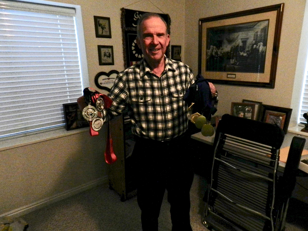 Stan Swallow with a variety of medals from National Championships and more. Photo by Brian Thompson