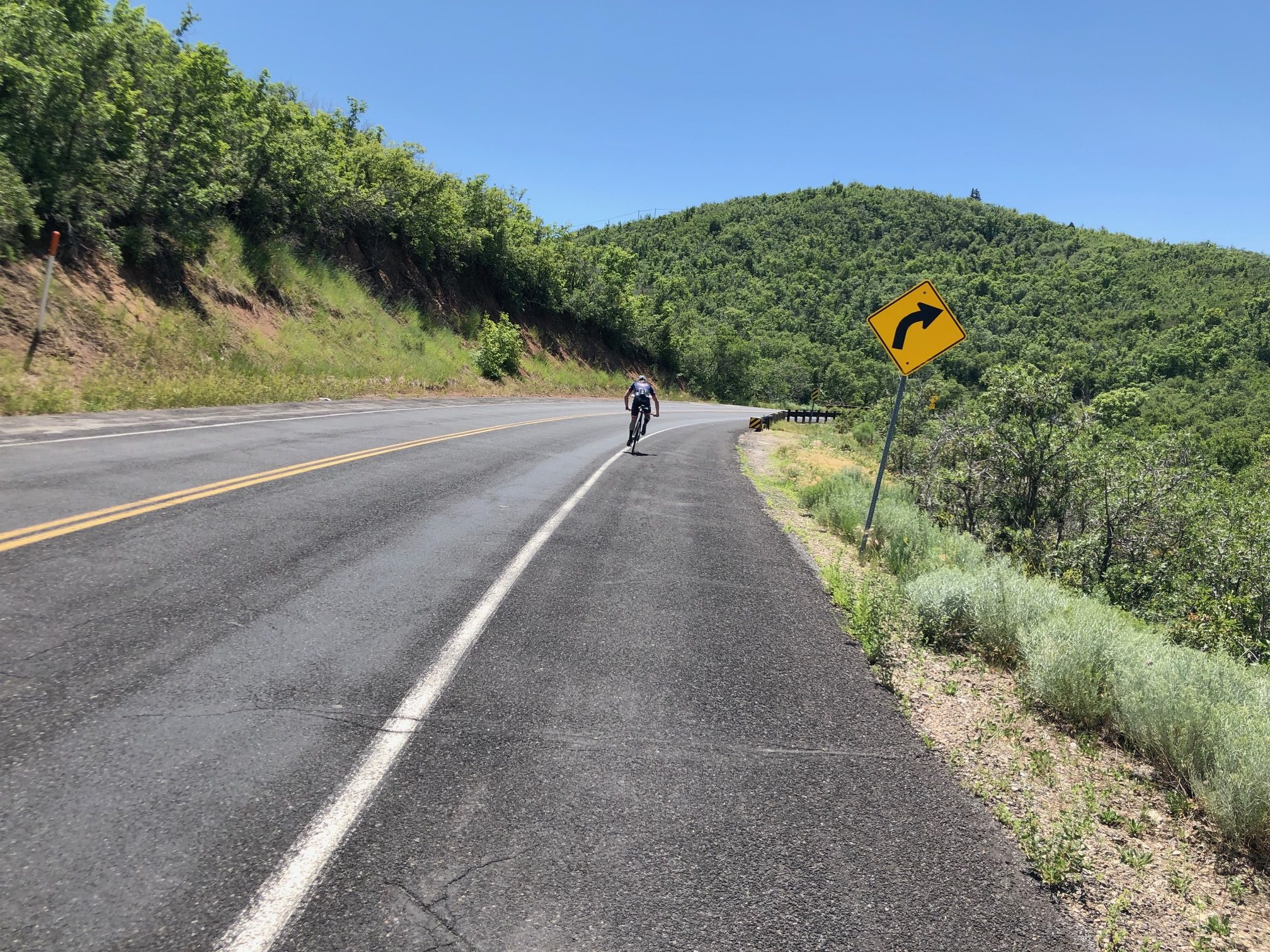 A cyclist descends Emigration Canyon with no cars around. Photo by Dave Iltis