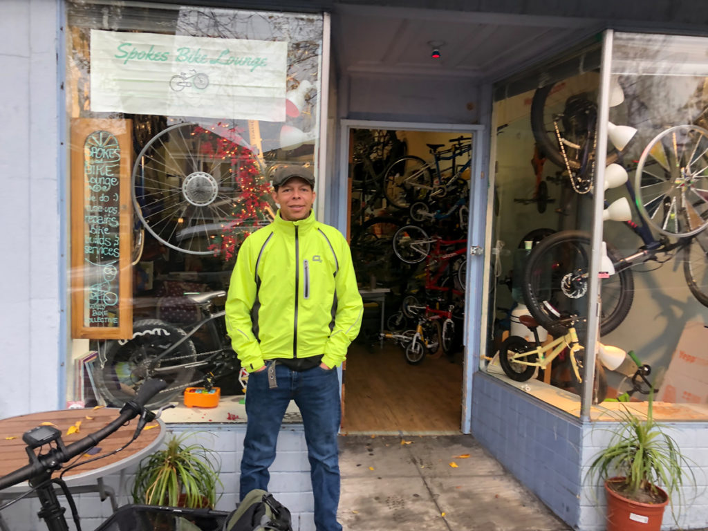 """""""The fastest growth in bicycling is among the Hispanic, African American and Asian American populations. Between 2001 and 2009, those three groups grew from 16 to 23 percent of all bike trips in the U.S. Within those groups, the percent of trips taken by bike has grown much faster than in the white population."""" (from the League of American Bicyclists The New Majority, Pedaling Towards Equity Report). Brian Drayton of Spokes Bicycle Lounge in Berkeley, California. Black owned bike shops like Spokes are a key reason for this growth. Photo by Dave Iltis"""