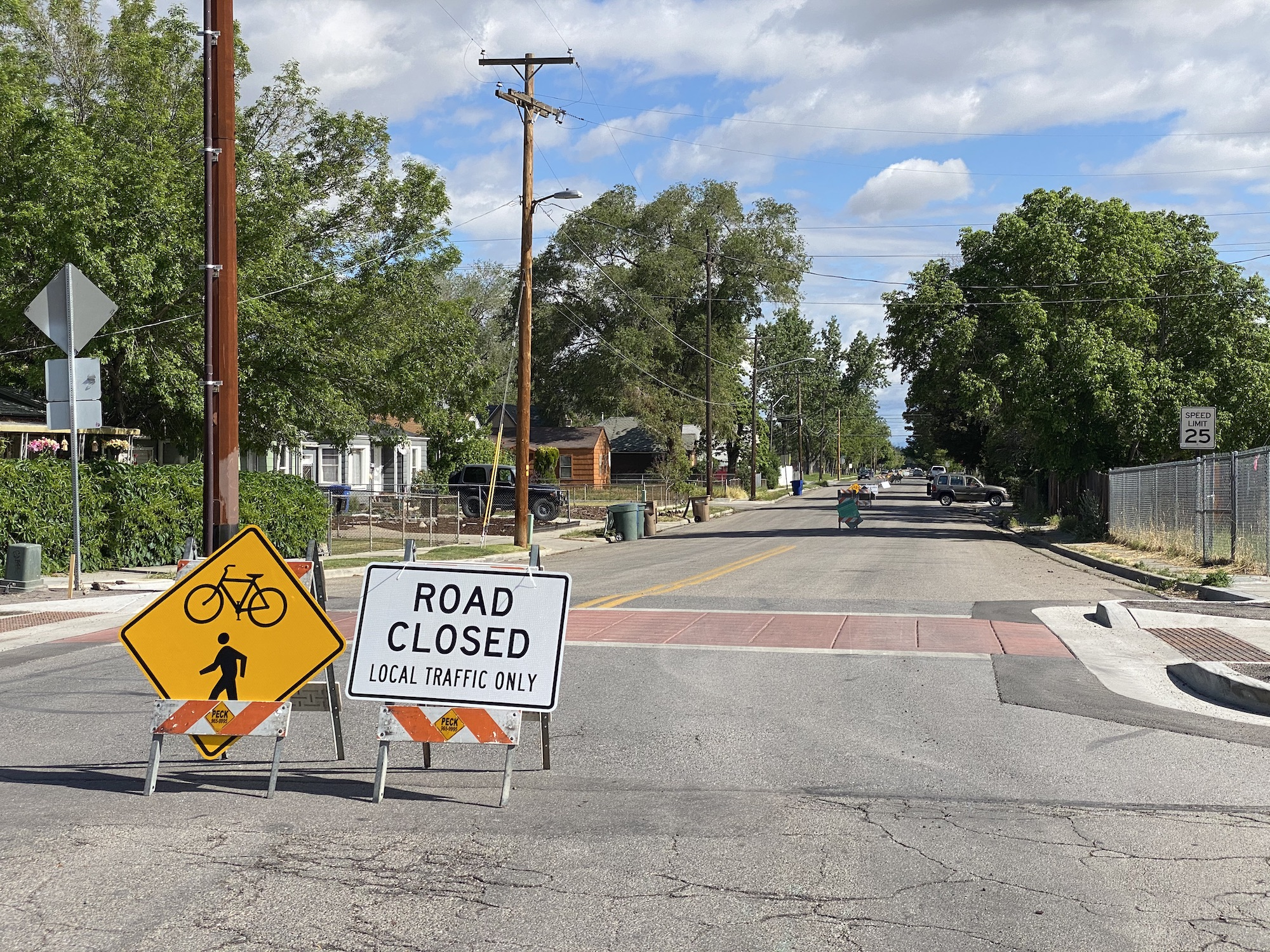 """Signs closing streets except to local traffic as part of SLC Mayor Erin Mendenhall's """"Stay Safe, Stay Active"""" plan during the Covid-19 pandemic. Photo by Turner Bitton"""