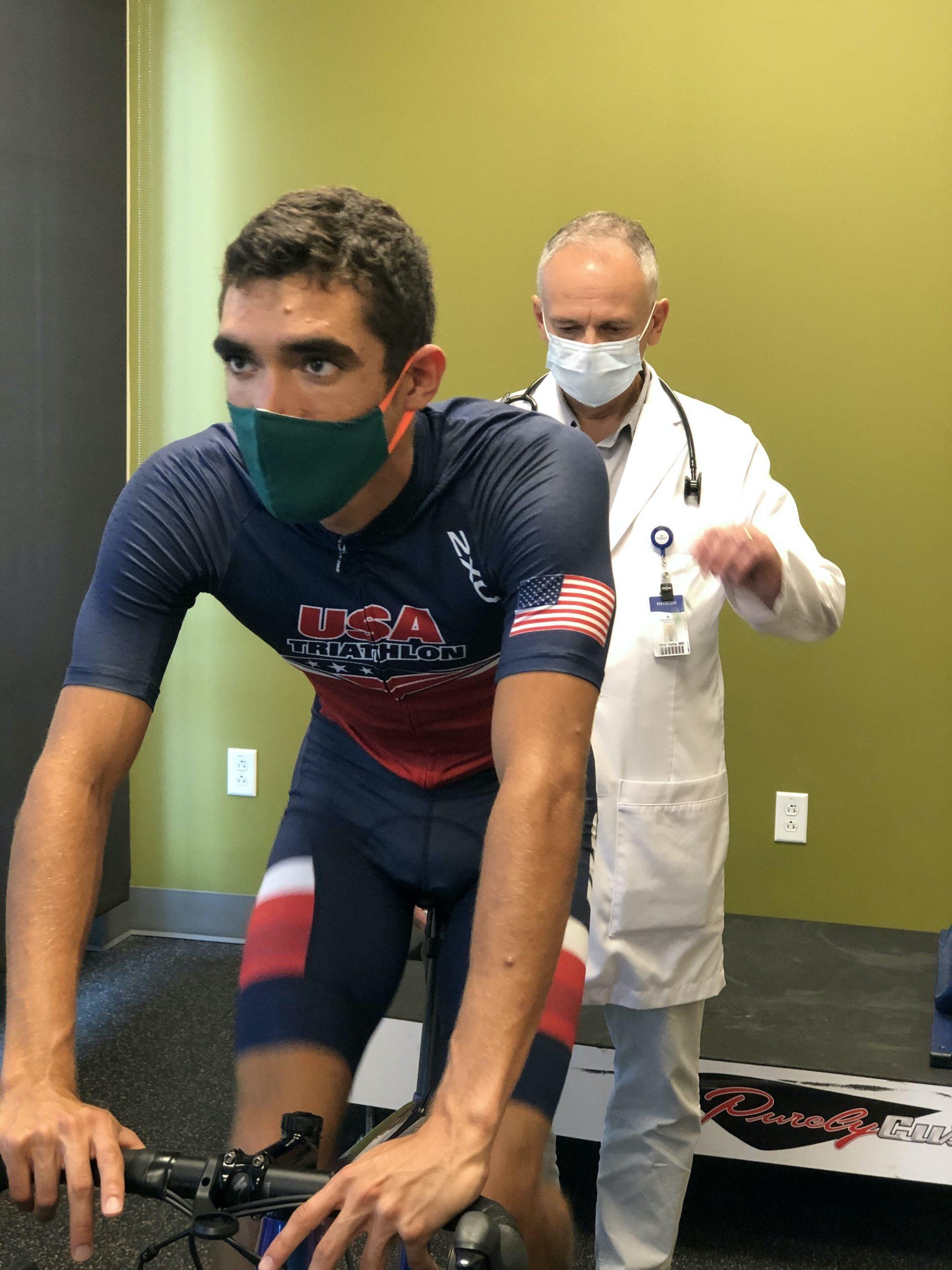 Dr. Max Testa working with USA Triathlon athlete Luis Ortiz. Photo courtesy Intermountain Healthcare